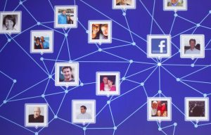 In this Feb. 29, 2012 photo, a graphic display of a Facebook network is shown at a Facebook event for marketing professionals in New York, where the social networking giant demonstrated new advertising opportunities as a prelude to its initial public offering of stock. Insiders and early Facebook investors are taking advantage of increasing investor demand and selling more of their stock in the company's IPO, which is set for Friday, May 18, 2012. But plans for the IPO were unfolding amid a debate over the effectiveness of Facebook advertising. (AP Photo/Mark Lennihan)